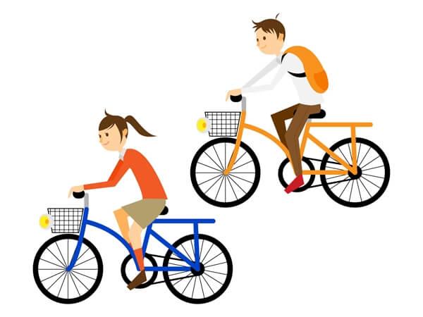 自転車に乗ってサイクリングする男女